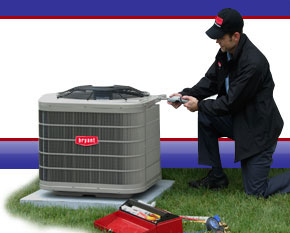 Image Of Worker Doing Air Conditioner Repair Novi, MI -  D & G Heating & Cooling, Inc.